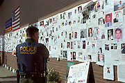 "A ferderal agent strolls down memorial wall at St. Vincents Hospital in Manhattanon Monday sept,17th one week after the sept. 11th attack on the world treade center. (Photo/Suzi Altman) Through my eyes and with my camera I am able to see the world we live in, and try to bring things into focus. Photography preserves my vision of what ""I see"" at a specific time and place- a moment. Creating a bond between  me and my subject and capturing and emotion for eternity. Having lived and worked in New York City for over 15 years when 911 happened. I had to go and ""see"" with my camera what lower Manhattan was like after this horrific attack on our Nation. The World Trade Center owned the skyline in lower Manhattan making it feel more like a canyon. After the Twin Towers fell, and I saw with my own eyes and camera the destruction, I realized what little land they actually sat on. The Twin Towers may not have occupied a large plot of land but they now touched everyones life. Photo©SuziAltman"