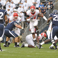 Oct 31, 2009; East Hartford, CT, USA; Rutgers cornerback Joe Lefeged (26) runs on a kickof return during second half Big East NCAA football action in Rutgers' 28-24 victory over Connecticut at Rentschler Field.