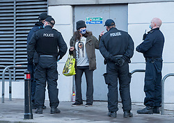 "© Licensed to London News Pictures; 25/01/2021; Bristol, UK. Colston Four at court. A woman chalks the words ""Support the Colston 4"" on the pavement outside court and is then arrested by police. Defendants Rhian Graham, 29, Milo Ponsford, 25, Jake Skuse, 32, and Sage Willoughby, 21, are due before Bristol Magistrates' Court for their first hearing today. They have been charged with criminal damage in connection with damage to the statue of slave trader Edward Colston which was pulled down during a Black Lives Matter protest on June 7 2020 and then thrown into Bristol Harbour. Police launched an appeal to trace suspects after the event and ten people were located. Six people accepted a caution while four were referred to the CPS. The statue was later retrieved by Bristol City Council who say that the damage is costed at £3,750. Police have warned anyone planning to protest at the court hearing that they will be breaking the lockdown laws which prohibit public gatherings of more than two people to combat the Covid-19 coronavirus pandemic. Photo credit: Simon Chapman/LNP."