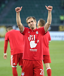 WOLFSBURG, April 30, 2017  Bayern Munich's Philipp Lahm greets the spectators after the German Bundesliga match between VfL Wolfsburg and Bayern Munich in Wolfsburg, Germany, on April 29, 2017. Bayern Munich won 6-0 to clinch its fifth consecutive Bundeslisga title ahead of schedule at the 31st round on Saturday. (Credit Image: © Xu Zijian/Xinhua via ZUMA Wire)