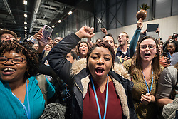 11 December 2019, Madrid, Spain: Protestors raise their hands into the air while calling out for climate justice, as hundreds of civil society and other actors hold an unauthorized protest outside the plenary hall of COP25 in Madrid, to draw attention to the failures of the climate talks and to call on rich countries to step up and pay up for real solutions, and to highlight the threat of loopholes, false solutions like carbon markets, and the need for those who caused the climate crisis to pay up for loss and damage while respecting human rights.