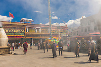 Tibetan pilgrims circumambulate through Barkhor Square and along The Barkhor (around the area of the Jokhang Temple), the most sacred temple in Tibet; Lhasa, Tibet, China.