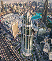 Aerial view of skyscrapers close by the Burj Khalifa tower and fountain in downtown Dubai, United Arab Emirates.