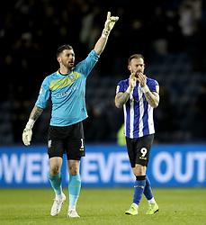 Sheffield Wednesday goalkeeper Keiren Westwood and Steven Fletcher clap off the fans