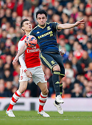 Kike of Middlesbrough is challenged by Laurent Koscielny of Arsenal - Photo mandatory by-line: Rogan Thomson/JMP - 07966 386802 - 15/02/2015 - SPORT - FOOTBALL - London, England - Emirates Stadium - Arsenal v Middlesbrough - FA Cup Fifth Round Proper.