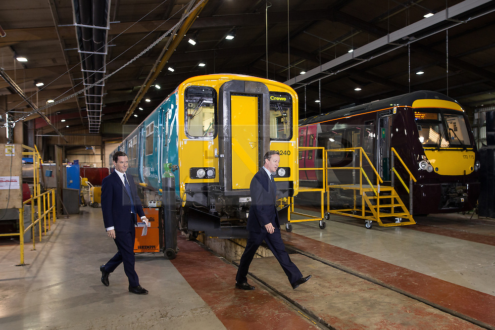 © Licensed to London News Pictures . 20/04/2015 . Crewe , UK . George Osborne and David Cameron arrive at an Arriva train shed in Crewe , Cheshire as part of the Conservative Party's election run . Photo credit : Joel Goodman/LNP