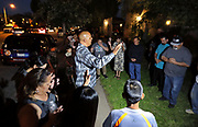 March 8, 2017_Escondido, California_USA_  Pastor Mark Madore, of Word of Life Worship Center in Escondido, leads a prayer for the 55 year old woman that was killed last night while driving by here at the 1800 block of E. Grand Avenue in what is suspected to be a gang shooting.  _Mandatory Photo Credit: Photo by Charlie Neuman