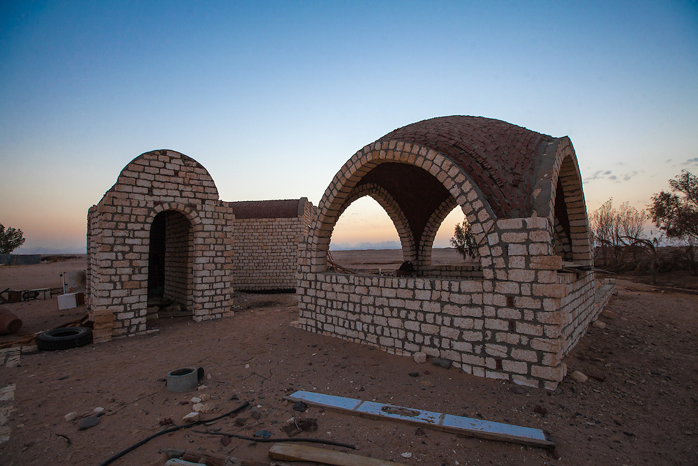 EGYPT. Hurghada. December 25th, 2013.  An abandoned home sits empty as the sunsets over the Sahara in the background.  The owner was forced to flee his home as it became too dangerous with groups of people stealing and looting in the area, along with rebels cutting off the water supply.