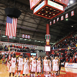 """Feb 21, 2009; Piscataway, NJ, USA; The Rutgers Scarlet Knights stand for the Rutgers alma mater """"On the Banks of the Old Raritan"""" following their 55-42 victory over Providence at the Louis Brown Athletic Center."""