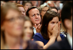 Image ©Licensed to i-Images Picture Agency. 28/09/2014. Birmingham, United Kingdom. The Prime Minister David Cameron listening to the Leader of the House of Commons William Hague deliver his last speech to the  Conservative Party Conference.Picture by Andrew Parsons / i-Images
