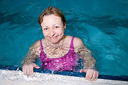 Woman in the swimming pool at her local leisure centre,