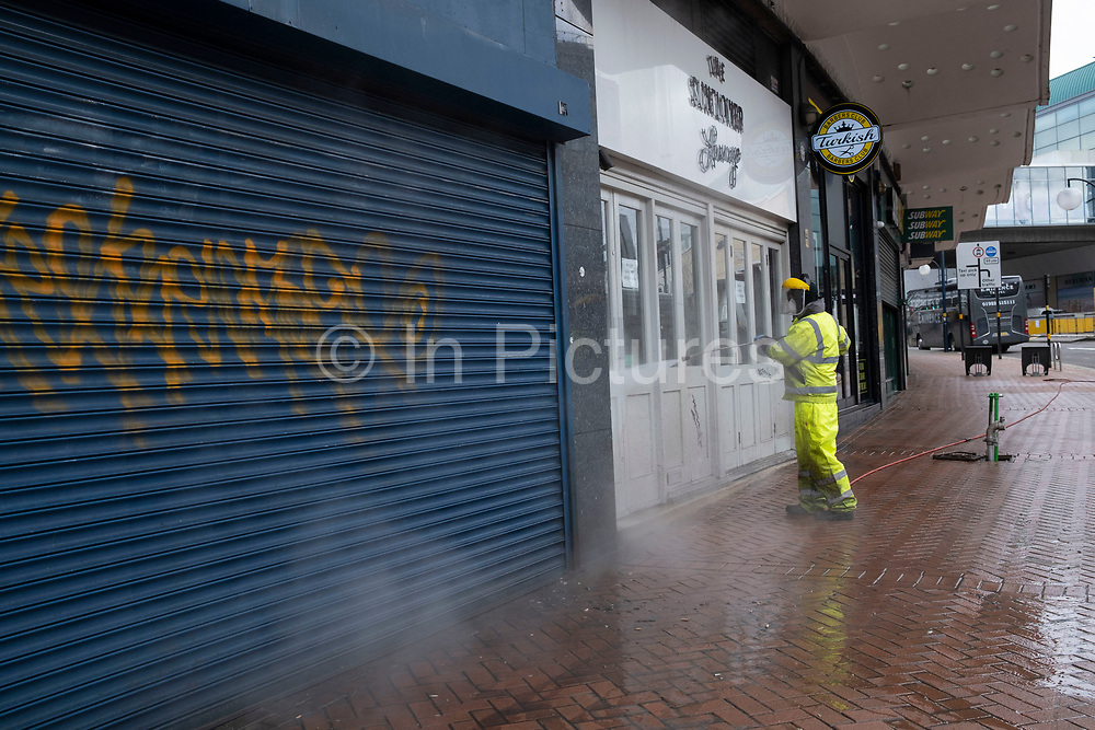 While Birmingham city centre is virtually deserted due to the Coronavirus outbreak a street cleaner jet washes the pavements along Smallbrook Queensway on 31st March 2020 in Birmingham, England, United Kingdom. Following government advice most people are staying at home leaving the streets quiet, empty and eerie. Coronavirus or Covid-19 is a new respiratory illness that has not previously been seen in humans. While much or Europe has been placed into lockdown, the UK government has announced more stringent rules as part of their long term strategy, and in particular social distancing.