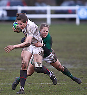 29 Feb 2010 Esher, Surrey: Emily Scarratt of England is tackled by Shannon Houston of Ireland during the Women's Six Nations game between England and Ireland at Esher Rugby Club (photo by Andrew Tobin/SLIK images)