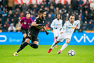 ( L-R ) Riyad Mahrez of Leicester City and Leon Britton of Swansea City in action. Premier league match, Swansea city v Leicester city at the Liberty Stadium in Swansea, South Wales on Saturday 21st October 2017.<br /> pic by Aled Llywelyn, Andrew Orchard sports photography.
