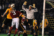 Newport keeper Alan Julian blocks a header from Wrexham's Neil Ashton (3). Blue Square Bet Premier division, Newport County FC v Wrexham at Rodney Parade in Newport, South Wales on Friday 4th Jan 2013. pic by Andrew Orchard, Andrew Orchard sports photography,