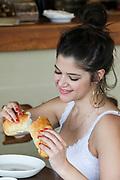 Young woman eats bread