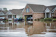 Covington Louisiana, March, 12, 2016,  A resdients in Tallow Creek subdivision surveys the floodwaters that continued to rise on Saterday afternoon..14 inches of rain fell in less than 24 hours, after three days of intermittent rain, causing flash floods. The Tchefuncte River and Bogue Falaya River<br />  crested on Saturday morning but the flood event continued into the night for those in Tallow Creek.