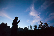 Leif Anderson brushes his teeth at camp at Cirque of the Towers in Popo Agie Wilderness, Wind River Range, Wyoming.