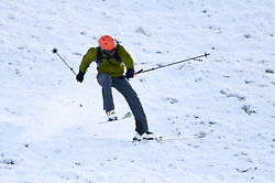 © Licensed to London News Pictures. 04/12/2020. <br /> A man skis down the slopes of Penyfan, in the Brecon Beacons, the highest point in southern Wales and England, which has seen it's first snowfall of the year. Photo credit: Robert Melen/LNP