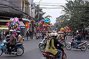 © Licensed to London News Pictures. 01/01/2012. Balloon sellers in a busy street, Hanoi, Vietnam. Photo credit : Stephen Simpson/LNP