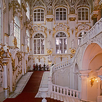 Tourists admire the massive grand entrance to the Winter Palace of the Czars in Saint Petersburg, Russia.