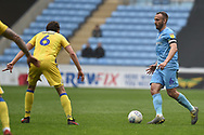 Coventry City midfielder Liam Kelly (6) looks to release the ball during the EFL Sky Bet League 1 match between Coventry City and Bristol Rovers at the Ricoh Arena, Coventry, England on 7 April 2019.