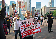 Protesters at a rally outside the venue for the National Rifle Association (NRA) annual meeting in Dallas, Texas, U.S., on Friday, May 4, 2018, where demonstrators called for tougher gun control laws.