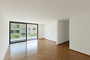 interior of an apartment, empty living room with balcony, parquet floor