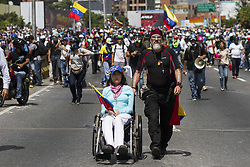 May 18, 2017 - Caracas, Venezuela - Venezuelan opposition activists clash with the riot police during a rally against the government of President Nicolas Maduro, in Caracas, on May 18, 2017. Venezuelan opposition leader Henrique Capriles said Thursday authorities confiscated his passport and prevented him from travelling to New York to discuss (Credit Image: © Panoramic via ZUMA Press)