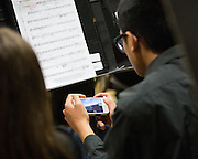 Students play videogames on their phones in between songs during the Milpitas Unified School District's Tenth Annual Music Festival at Milpitas High School in Milpitas, California, on April 4, 2013. (Stan Olszewski/SOSKIphoto)