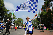 a Sheffield Wednesday fan waving flag outside Wembley Stadium before k/o. Skybet football league Championship play off final match, Hull city v Sheffield Wednesday at Wembley Stadium in London on Saturday 28th May 2016.<br /> pic by John Patrick Fletcher, Andrew Orchard sports photography.