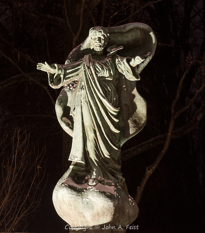 This statue stands in a prayer garden at Loyola House of Retreats in Morristown, NJ. The statue is inspiring and humbling. The illumination from the ground creates a beautiful effect in this nighttime shot.