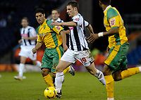 Photo: Leigh Quinnell.<br /> West Bromwich Albion v Norwich City. Coca Cola Championship. 11/11/2006. West Broms Jason Koumas looks to shake off Norwichs' Youssef Safri.