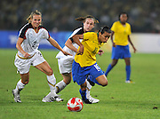 Beijing, CHINA.   Olympic Football, Women's Gold  Medal Game, USA vs BRA, Brazils, MARTA, inside the USA defenders, during the first half at the Beijing Workers Stadium. Thursday,  21.08.2008 [Mandatory Credit: Peter SPURRIER, Intersport Images]