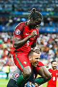 Ederzito, the scorer of the goal that made Portugal win the match and the Euro Cup against France by 1-0, mounted on the shoulders of goalkeeper Eduardo.
