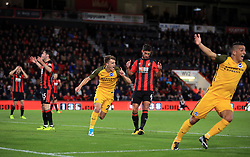 Brighton & Hove Albion's Solly March (centre left) celebrates scoring his side's first goal of the game during the Premier League match at the Vitality Stadium, Bournemouth.