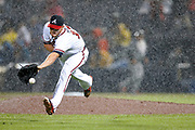 ATLANTA, GA - APRIL 13:  Pitcher Shelby Miller #17 of the Atlanta Braves fields a ground ball in the pouring rain in the fourth inning of the game against the Miami Marlins at Turner Field on April 13, 2015 in Atlanta, Georgia.  (Photo by Mike Zarrilli/Getty Images) *** Local Caption *** Shelby Miller