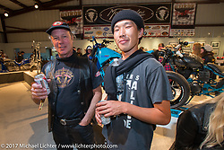 Jonathan Pite with photographer and show particpant Heeko Narihiko Kumagae at the Old Iron - Young Blood exhibition media and industry reception in the Motorcycles as Art gallery at the Buffalo Chip during the annual Sturgis Black Hills Motorcycle Rally. Sturgis, SD. USA. Sunday August 6, 2017. Photography ©2017 Michael Lichter.