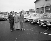 Tubberware Girls - New Cars 31/05/1976.05/31/1976.31st May 1976.Pictured from left to right Michael Rowe, Managing Director Chrysler (Ireland) Limited, Louise Coleman, Tupperware Distributor and Hugh Crawford, Managing Director Crawford's Dun Laoghaire. They are pictured next to Hillman Hunter cars.