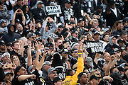 Oakland Raiders fans cheer as the Oakland Raiders take on the Buffalo Bills at Oakland Coliseum in Oakland, Calif., on December 4, 2016. (Stan Olszewski/Special to S.F. Examiner)