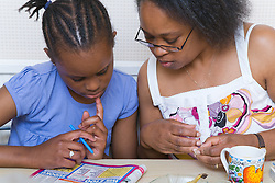 Mother and teenage daughter doing a puzzle together,