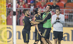 TORONTO, Sept. 2, 2018  Lee Nguyen (2nd L) of Los Angeles Football Club celebrates scoring with teammates during the 2018 Major League Soccer (MLS) match between Toronto FC and Los Angeles Football Club at BMO Field in Toronto, Canada, Sept. 1, 2018. Toronto FC lost 2-4. (Credit Image: © Xinhua via ZUMA Wire)