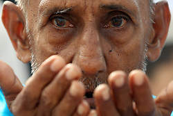 June 26, 2017 - Colombo, Western Province, Sri Lanka - A Sri Lankan Muslim man prays during Eid-ul-Fitr prayers at the Galle Face Green in Colombo, Sri Lanka, 26 June 2017.  Eid-ul-Fitr is the first day of the Islamic month of Shawwal. It marks the end of Ramadan, which is a month of fasting and prayer. (Credit Image: © Sanka Vidanagama via ZUMA Wire)