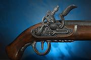 Close up trigger and firing mechanism of an ancient flintlock pistol