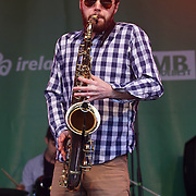 Booka Brass Band performs at the St Patrick's Day festival and Parade in London set to go green for another world-class 2016 on 13th March 2016 in Trafalgar Square, London, England,UK. Photo by © 2016