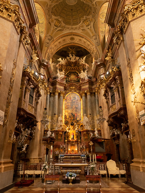 The beautiful Altar of St. Peter`s Church with magnificent carved sculptures and large icons in Vienna, Austria