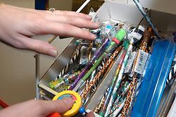 Shop worker sorting stationery supplies in shop; Merseyside UK