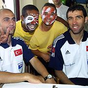 Turkish soccer  National team preparation world Cup 2002. Player Hasan SAS(L) with Hakan SUKUR(R) and Brasil people(C) during their lunch Gloria Verde Resort in Belek/Antalyal/TURKEY .<br /> Photo by Aykut AKICI/TurkSporFoto
