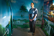 Writer Mike Finkel in a photo studio. In the border town of Ishkashim, on the Tajikistan - Afghanistan border. Hindukush mountains.