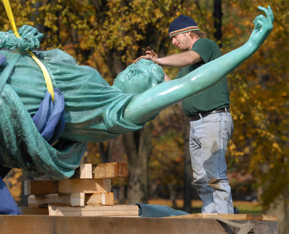 NE11/1/06 2Angel<br /> ML0314A<br /> The Angel of Peace is prepared for her move from the New Haven Green to the summit of East Rock Park by Mariano Brothers Specialty Movers of Bethel workman Doug Hertz. Photo by Mara Lavitt